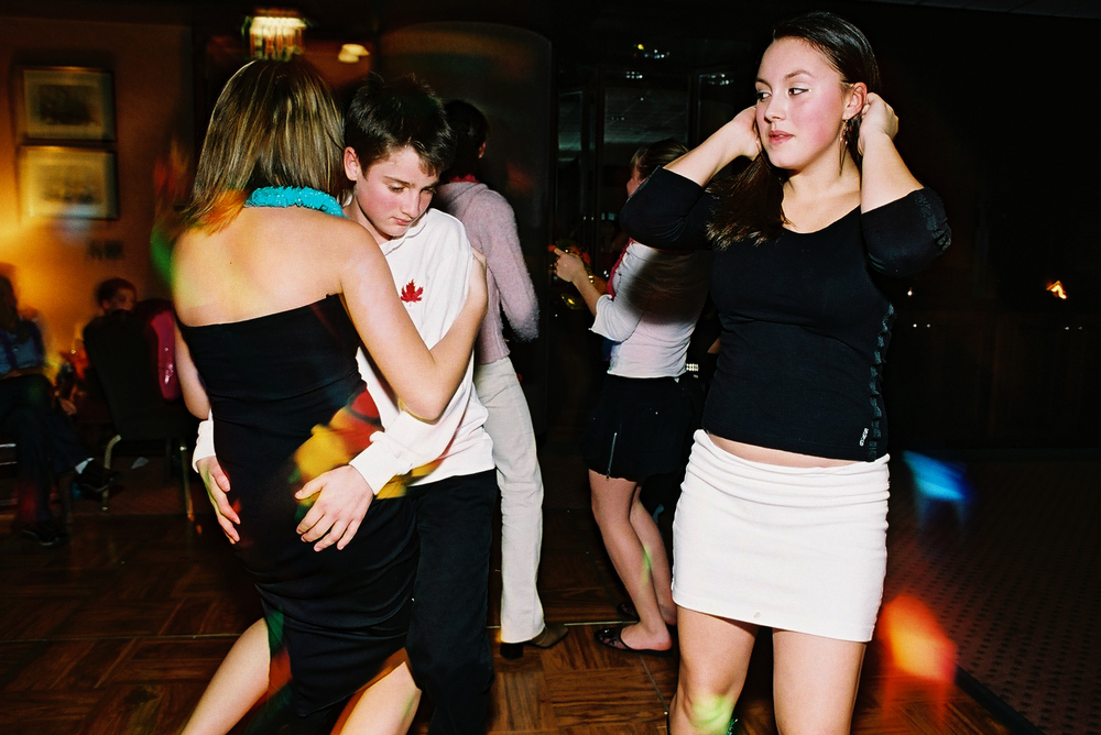 image 2 of 6 Teenagers dancing intimately at a party