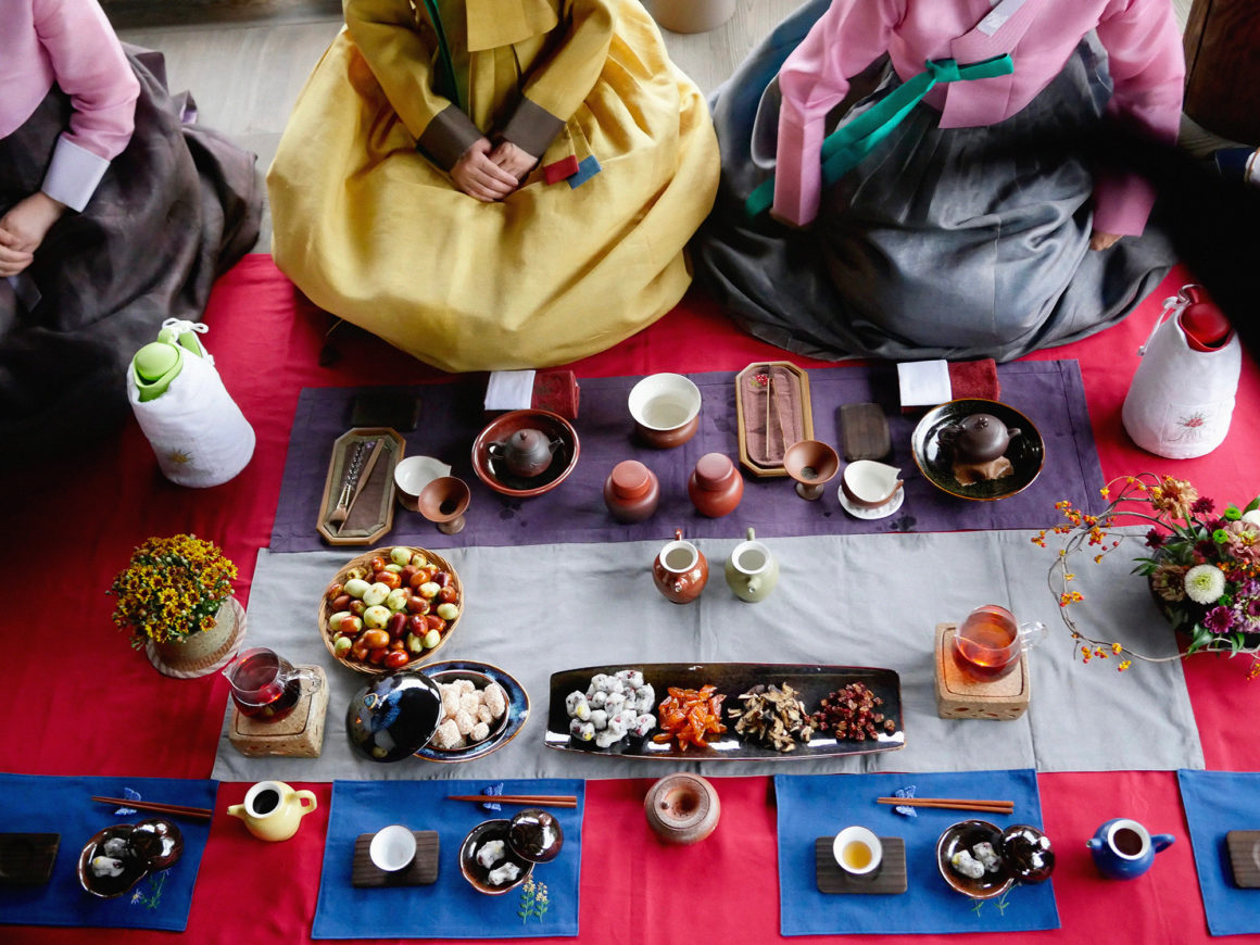 Image 1 Artist Dina Goldstein's photos taken in South Korea. Includes traditional tea party, street portraits and candids of people in everyday life.